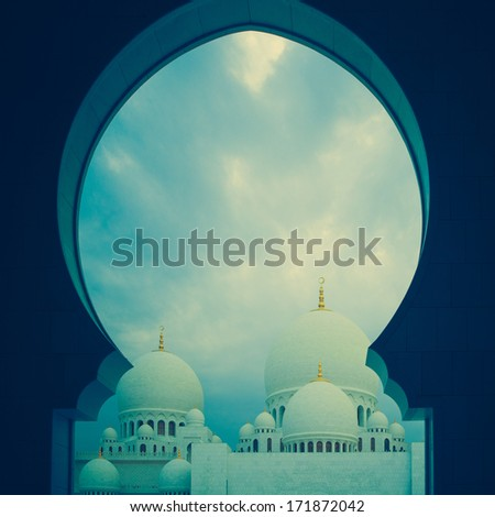 blue and white history heritage islamic mosque in abu dhabi - stock photo