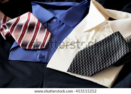 blue and white men`s classic shirts with two ties - stock photo