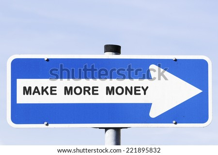 blue and white one-way street sign on a metal mast in front of the blue sky. Make more money is written on the white arrow. Business concept for success and motivation. - stock photo