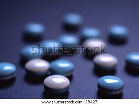 Blue and white pills. - stock photo