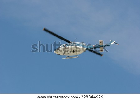 blue and white police helicopter, italy, polizia - stock photo
