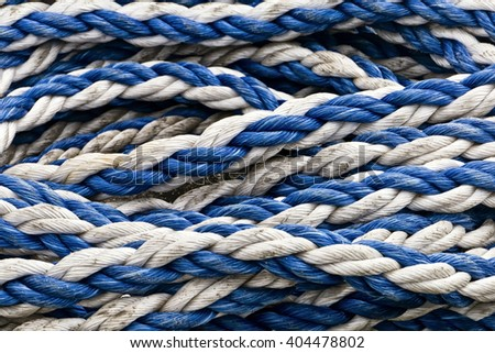 Blue and white ropes; background of blue and white polypropylene ropes  - stock photo