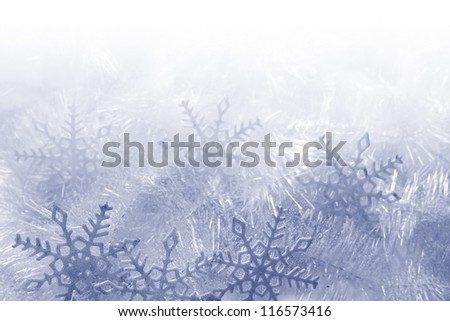 Blue and white snowflakes on a blue and white background - stock photo
