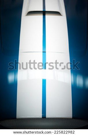 Blue and White Striped Hood with Hood Vent of Classic Car - stock photo