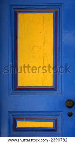 Blue and yellow door - stock photo