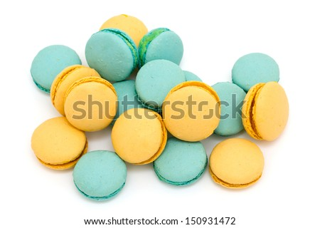 blue and yellow macarons over white