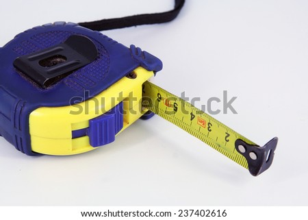 Blue and yellow meter. Home tool. - stock photo
