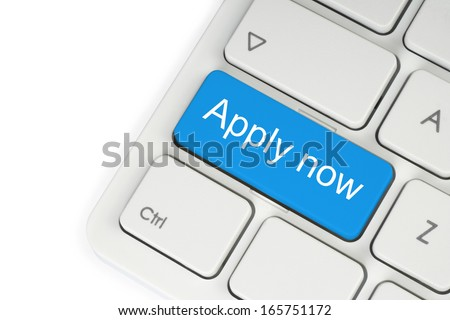 Blue apply now button on white keyboard close-up