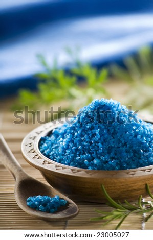 blue aromatic salt in a wooden bowl close up shoot - stock photo