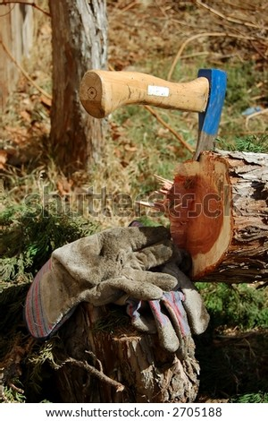 Blue Axe and cut down tree - stock photo