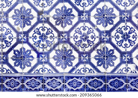 Blue azulejos on the building's exterior in Lisbon, Portugal.