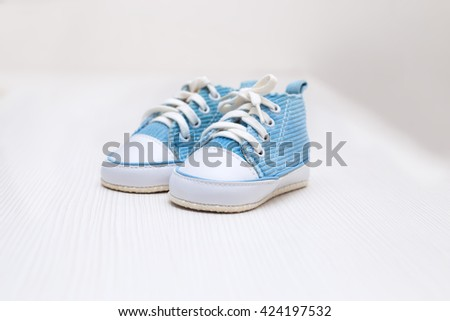 blue baby booties - stock photo