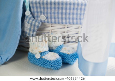 Blue baby boy shoes in children room - stock photo
