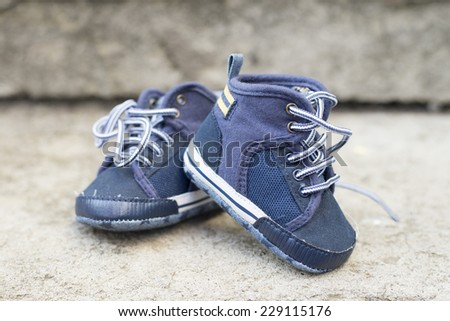 blue baby boy sneakers - stock photo