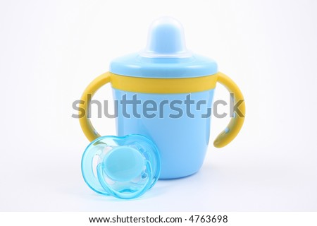 blue baby cup and pacifier - stock photo