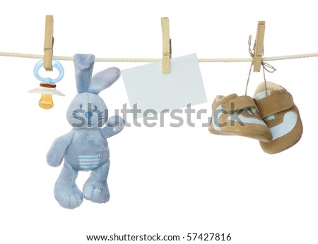 Blue baby goods and blank note hanging on the clothesline - stock photo