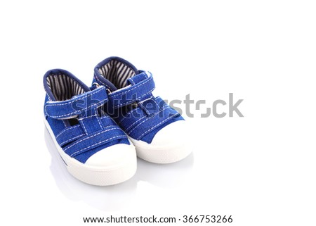 blue baby shoes on white - baby stuff - stock photo