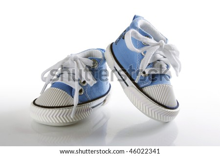 Blue baby shoes with reflection - stock photo