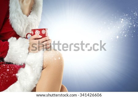 blue background and winter red mug  - stock photo