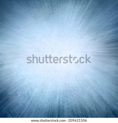 Blue background, blue streaks of light radiate from center to dark blue frame in sunburst pattern  - stock photo