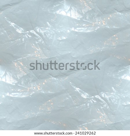 blue background - crumpled plastic film, plastic bag waste, seamless pattern - stock photo