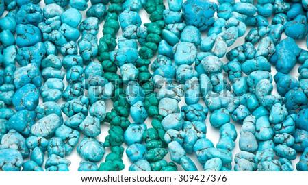 blue background natural turquoise stone - stock photo