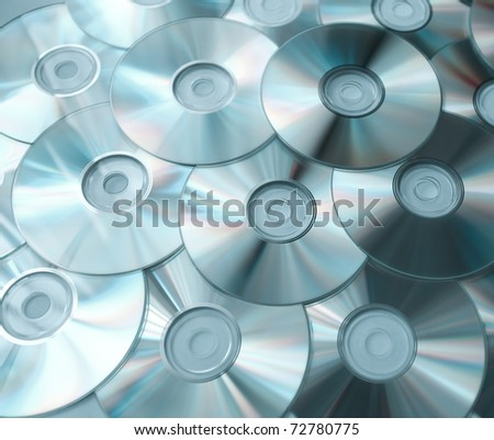 blue background of compact discs - stock photo