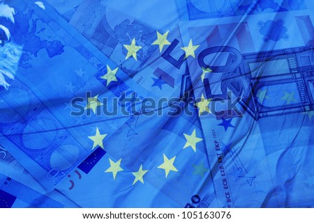 blue background with euro bills and european union flag symbolizing euro zone - stock photo