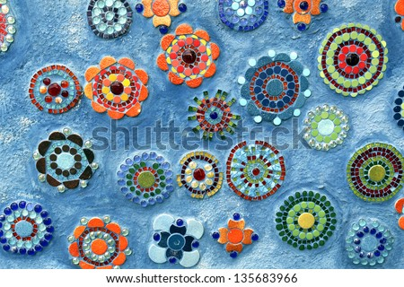 Blue background with mosaic flowered pattern - stock photo