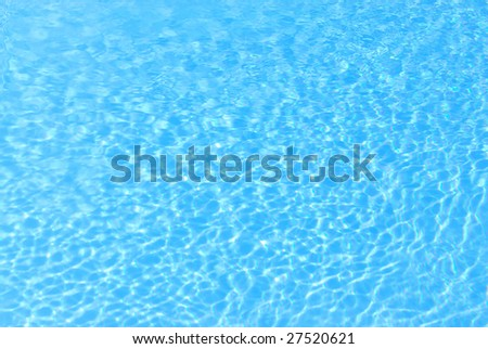 blue background with sun reflected in the swimming-pool water - stock photo