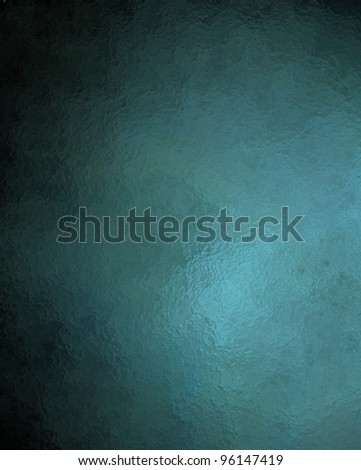blue background with vintage grunge texture and dark black vignette border on frame with copy space - stock photo