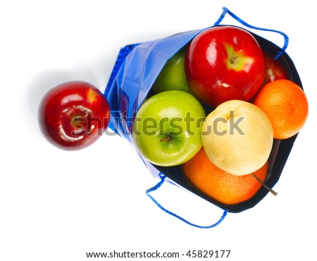 Blue bag with fruits isolated on white - stock photo