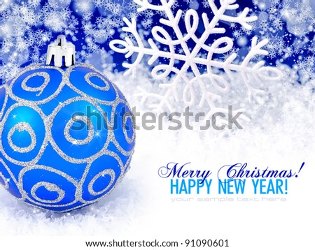 Blue ball and snowflake winter snow background with space for text - stock photo