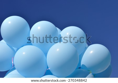 blue balloons in the city festival on blue sky background - stock photo