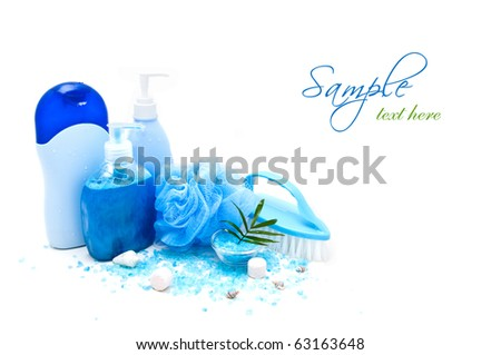 Blue bath accessories with seashells isolated on white - stock photo