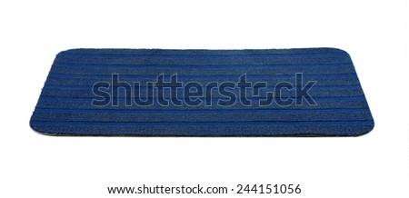 Blue bath rug isolated on white - stock photo