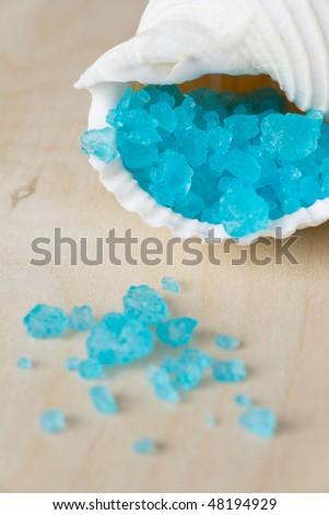 Blue bath salt in white seashell - stock photo