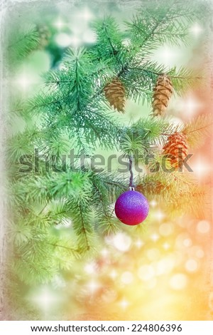 Blue bauble on Christmas tree (xmas ball) and Christmas light - stock photo