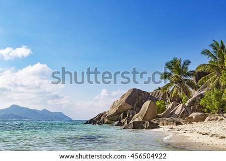 Blue bay tropical beach with rocks, white sand and blue sky, famous anse source d'argent on La Digue, Seychelles islands - stock photo
