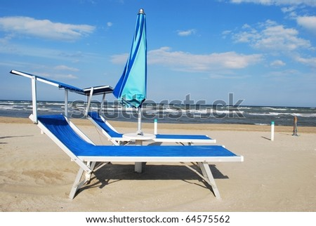 Blue beach chairs and umbrella, Rimini, Italy