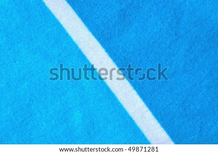 Blue beach towel useful as a background texture /  pattern - stock photo