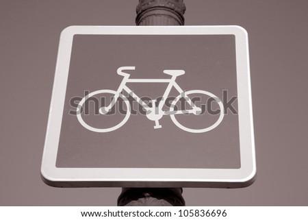 Blue Bike Sign on Sky Background - stock photo