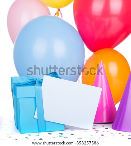 Blue birthday gift box with balloons and party hats - stock photo