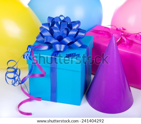 Blue birthday gift box with party decorations - stock photo
