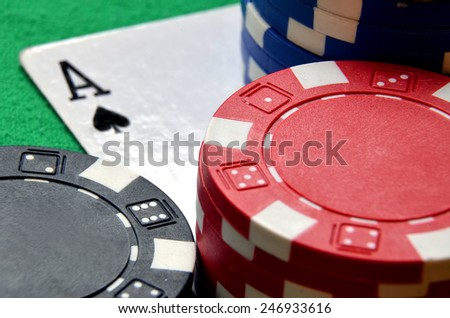Blue, black and red poker chips pile and ace detail - stock photo