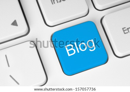 Blue blog button on keyboard background   - stock photo