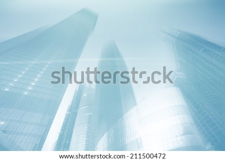 blue blurred background skyscrapers city - stock photo