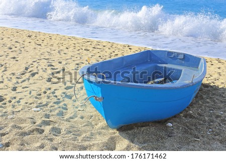 blue boat on beach - stock photo