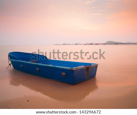 blue boat on the beach. little fishing boat on the beach.