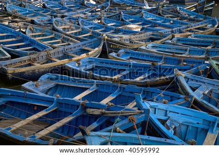 Blue boats in harbor